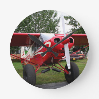Red and white aircraft, Alaska Round Clock