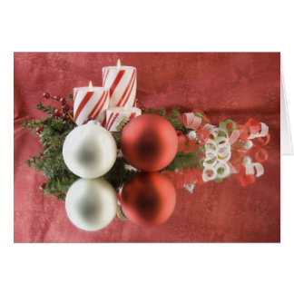 red and white christmas ornaments with candles card
