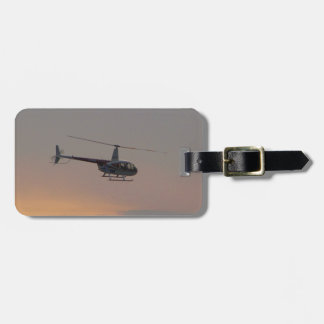 Red and white R44 at sunset. Luggage Tag