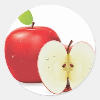 Red apple and half of apple round sticker