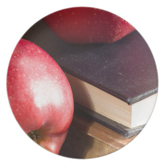 Red apples and old vintage book plate