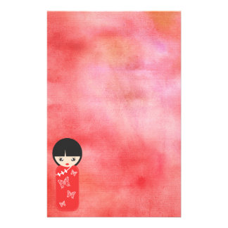 Red Asian Doll Against Watercolor Red Stationery