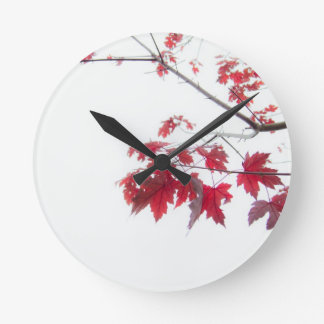 red autumn leaves on a branch round clock