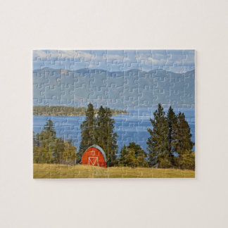Red barn sits along scenic Flathead Lake near Jigsaw Puzzle