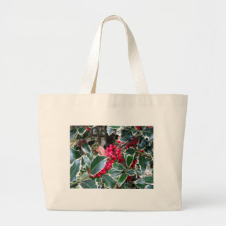 Red berries from a holly tree jumbo tote bag