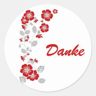 red blooms round sticker