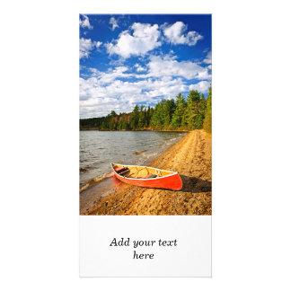 Red canoe on lake shore custom photo card