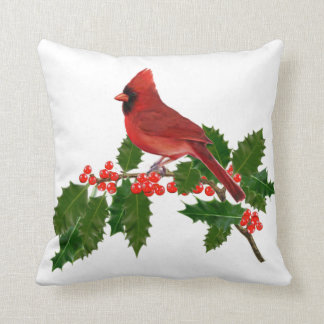 RED CARDINAL PERCHED ON HOLLY CUSHION