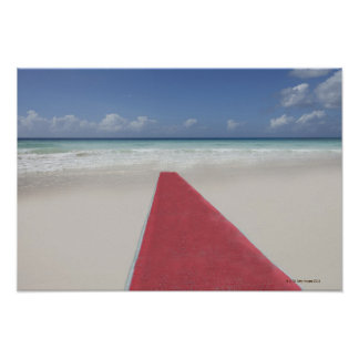 Red carpet on a beach poster