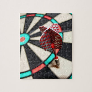 Red checkered dart on dartboard jigsaw puzzle