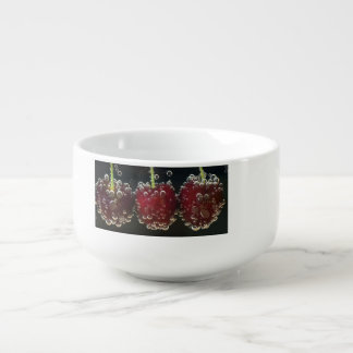 Red cherries in the water soup bowl with handle