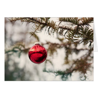 red Christmas ball at branch of fir Card