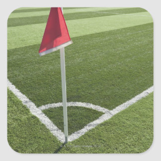 Red corner flag on soccer field square sticker