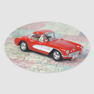Red Corvette on Road Map Oval Sticker
