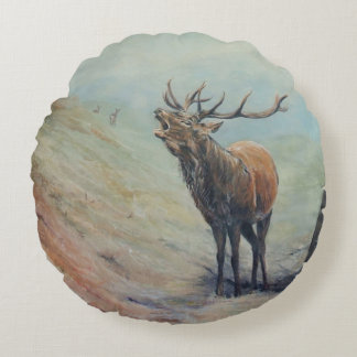 Red deer stag with hind and fawn on back. round cushion