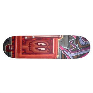 Red graffiti face skate deck