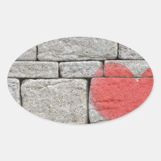 Red Graffiti Heart on Stone Wall Oval Sticker