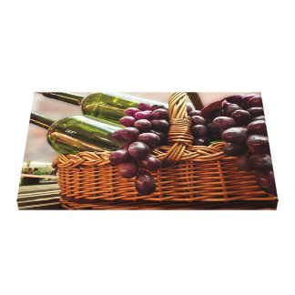 Red grapes and two green glass bottles of wine canvas print