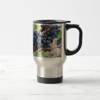Red grapes on the vine with green leaves travel mug