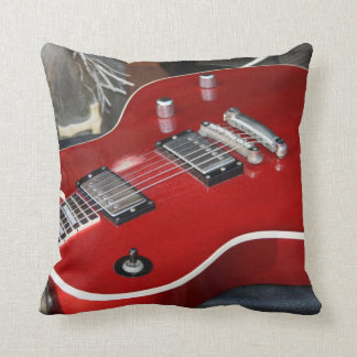 Red guitar on amp cushion