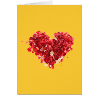 Red heart made of rose petals greeting card