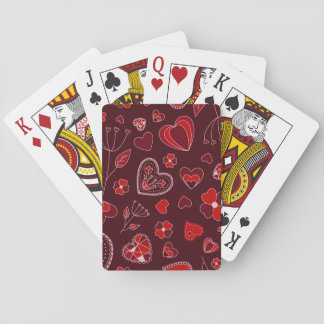 Red hearts and flowers playing cards