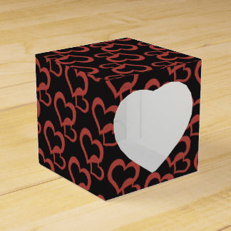 red hearts on black background party favour box