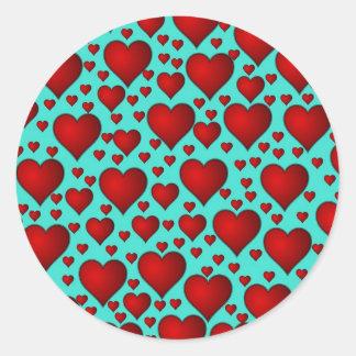 Red Hearts on Blue Background Round Sticker