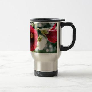Red Hollyhock flowers in bloom Mug