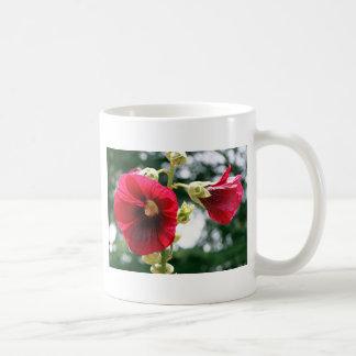 Red Hollyhock flowers in bloom Coffee Mug
