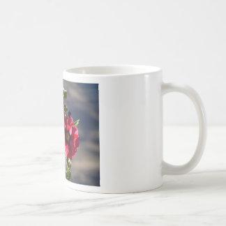 Red Hollyhocks in a summer garden Coffee Mug