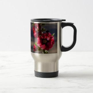 Red Hollyhocks in a summer garden Travel Mug