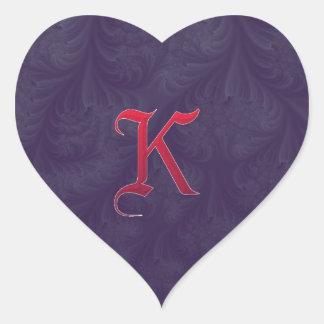 Red 'K' on purple embossed effect 3D fractal. Heart Sticker