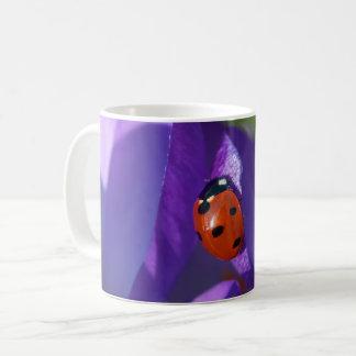 Red ladybird on crocus coffee mug