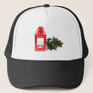 Red lantern with tealight holly twigs and berries trucker hat