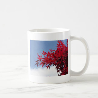 Red maple leaves against the blue sky coffee mug