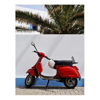 Red motor scooter by wall, Stromboli Island, Postcard