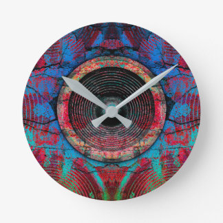 Red music speakers on a cracked wall round clock