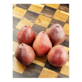 Red Pears on a Wooden Chess Board Postcard