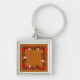 Red peppers on a dark gold background key ring