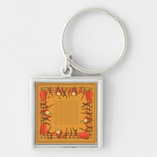 Red peppers on a light gold background key ring