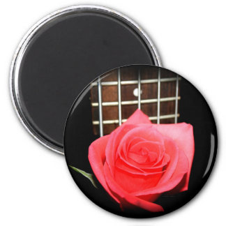 Red pink rose against five string bass fret board 6 cm round magnet