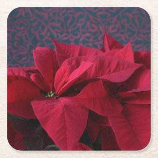 Red poinsettias on decorative background square paper coaster