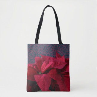 Red poinsettias on decorative background tote bag