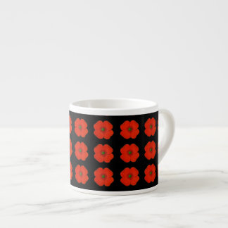 Red poppy flowers with black matt background espresso cup