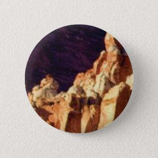 red rock formations in stone 6 cm round badge