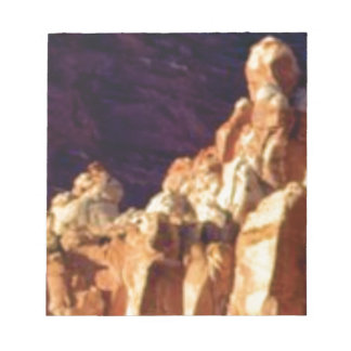 red rock formations in stone notepad