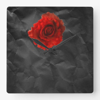 Red rose on black wall clock