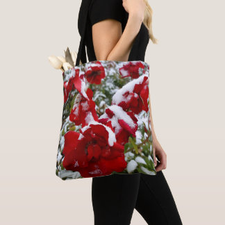 Red roses covered by snow and rime tote bag