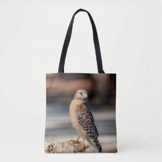 Red Shouldered Hawk on a rock Tote Bag